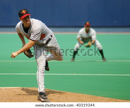 SCRANTON - JULY 31: Rochester Red Wings pitcher follows through on a pitch against the Scranton Wilkes Barre Red Barons in a game at PNC Field on July 31, 2005 in Scranton, PA. - stock photo