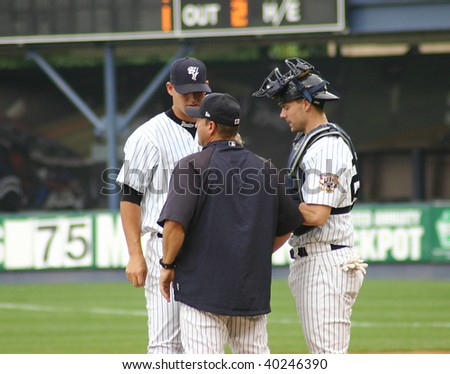SCRANTON - JUNE 26: Scranton Wilkes Barre Yankees pitcher, catcher and manager have a conference during  a game at PNC Field June 26, 2008 in Scranton, PA - stock photo