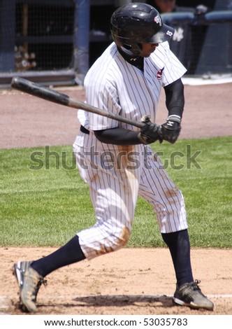 SCRANTON - May 13: Scranton Wilkes Barre Yankees Eduardo Nunez bats in a game against Columbus Clippers in a game at PNC Field May 13, 2010 in Scranton, PA - stock photo