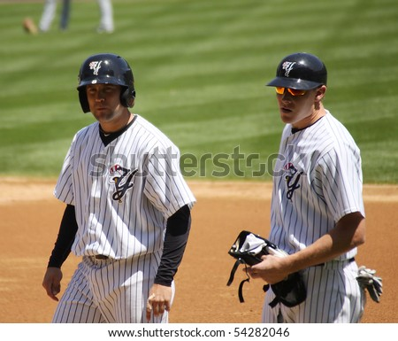 SCRANTON - May 13: Scranton Wilkes Barre Yankees Reed Gorecki talks to the first base coach n a game against Columbus Clippers in a game at PNC Field May 13, 2010 in Scranton, PA - stock photo