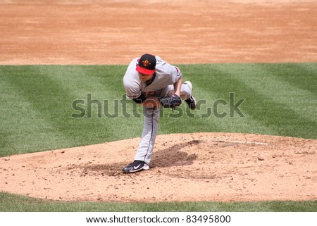 SCRANTON, PA - AUGUST 24: Rochester Red Wings pitcher Eric Hacker follows through during a game against the Scranton Wilkes Barre Yankees at PNC Field on August 24, 2011 in Scranton, PA. - stock photo