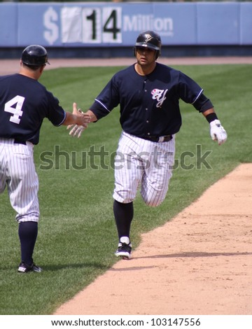 SCRANTON, PA - AUGUST 24: Scranton Wilkes Barre Yankees catcher Gustavo Molina is congratulated after a homerun against the Rochester Red Wings at PNC Field on August 24, 2011 in Scranton, PA. - stock photo