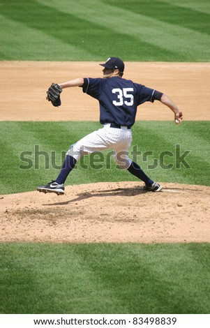 SCRANTON, PA - AUGUST 24: Scranton Wilkes Barre Yankees pitcher David Phelps fires a pitch in a game against the Rochester Red Wings at PNC Field on August 24, 2011 in Scranton, PA. - stock photo