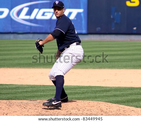 SCRANTON, PA - AUGUST 24: Scranton Wilkes Barre Yankees pitcher George Kontos fires a pitch in a game against the Rochester Red Wings at PNC Field on August 24, 2011 in Scranton, PA. - stock photo