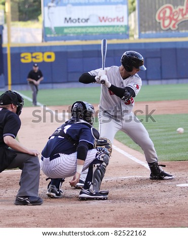 SCRANTON, PA - JULY 9: Rochester Red Wings batter Aaron Bates swings at a pitch in a game against the Scranton Wilkes Barre Yankees at PNC Field on July 9, 2011 in Scranton, PA. - stock photo