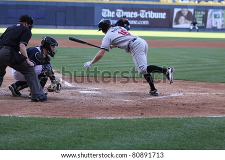 SCRANTON, PA - JULY 9: Rochester Red Wings batter Dustin Martin moves out of the way of  a pitch in a game against the Scranton Wilkes Barre Yankees at PNC Field on July 9, 2011 in Scranton, PA. - stock photo