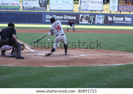 SCRANTON, PA - JULY 9: Rochester Red Wings batter Dustin Martin swings at a pitch a pitch in a game against the Scranton Wilkes Barre Yankees at PNC Field on July 9, 2011 in Scranton, PA. - stock photo