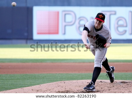 SCRANTON, PA - JULY 9: Rochester Red Wings pitcher Eric Hacker fires a pitch in a game against the Scranton Wilkes Barre Yankees at PNC Field on July 9, 2011 in Scranton, PA. - stock photo