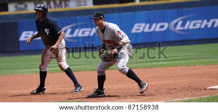 SCRANTON, PA - MAY 24: Indianapolis Indians First Baseman Matt Hague holds the runner during a game against the Scranton Wilkes Barre Yankees at PNC Field on May 24, 2011 in Scranton, PA. - stock photo