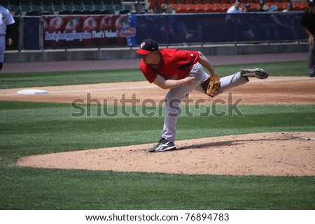 SCRANTON, PA - MAY 8: Pawtucket Red Sox pitcher Brandon Duckworth follow through on a pitch in a game against the Scranton Wilkes Barre Yankees at PNC Field on May 8, 2011 in Scranton, PA. - stock photo
