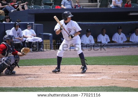 SCRANTON, PA - MAY 8: Scranton Wilkes Barre Yankees batter Daniel Brewer #3 looks to lay down a bunt against the: Pawtucket Red Sox at PNC Field on May 8, 2011 in Scranton, PA. - stock photo