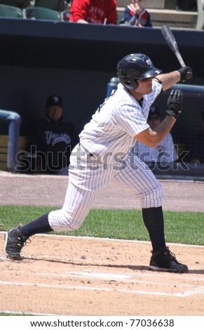 SCRANTON, PA - MAY 8: Scranton Wilkes Barre Yankees batter #21 Jesus Montero swings at a pitch in a game against the Pawtucket Red Sox at PNC Field on May 8, 2011 in Scranton, PA. - stock photo