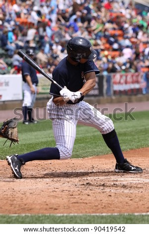 SCRANTON, PA - MAY 24: Scranton Wilkes Barre Yankees batter Justin Maxwell swings during a game against the Indianapolis Indians at PNC Field on May 24, 2011 in Scranton, PA. - stock photo