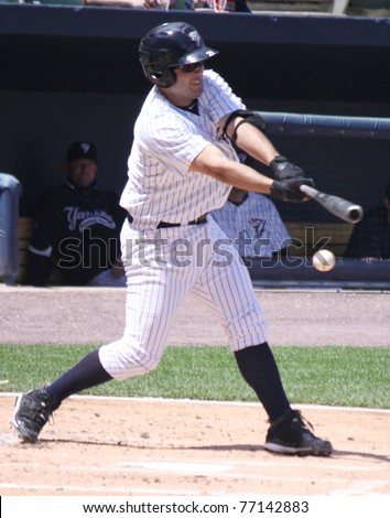 SCRANTON, PA - MAY 8: Scranton Wilkes Barre Yankees batter (No. 21) Jesus Montero swings at a pitch in a game against the Pawtucket Red Sox at PNC Field on May 8, 2011 in Scranton, PA. - stock photo