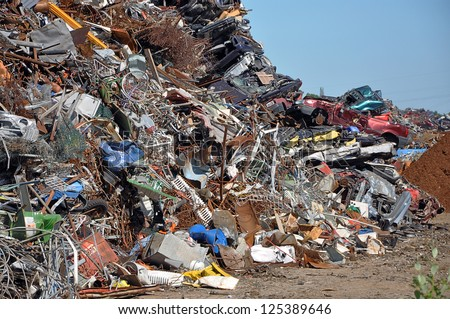 Scrap heap - Scrap Metal ready for recycling with blue sky - stock photo