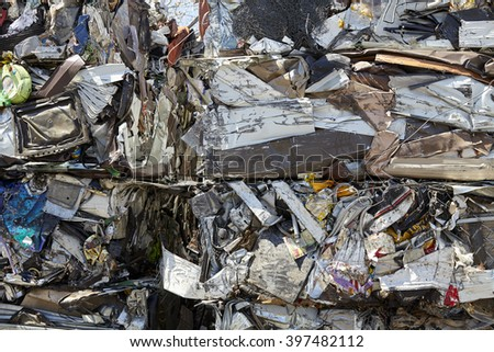 Scrap metal refuse compacted for recycling