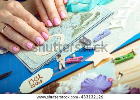scrapbook background. Hands, Card and tools with decoration.  - stock photo