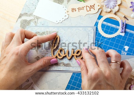 scrapbook background. Hands, Card and tools with decoration. Love