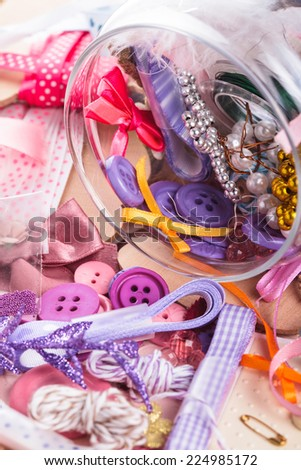 Scrapbooking craft materials in a glass bottle - stock photo