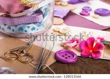 Scrapbooking craft materials in glass bottle - stock photo