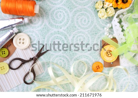 Scrapbooking craft materials on light background - stock photo