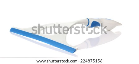 Scraper for cleaning windows with rubber tread. - stock photo