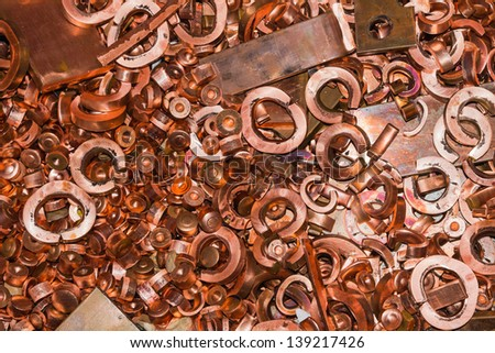 Scrapheap of copper from hole punching and shearing process, waiting for recycling - stock photo