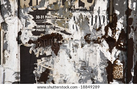 Scraps of paper on a wall. Grunge background. - stock photo