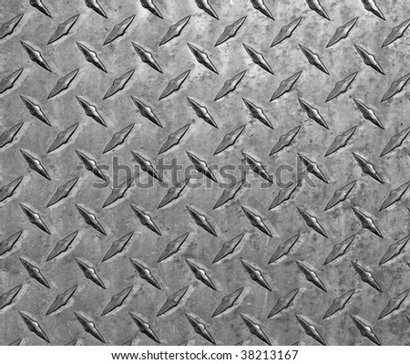 Scratched and dirty diamond plate steel.  Makes a great background. - stock photo