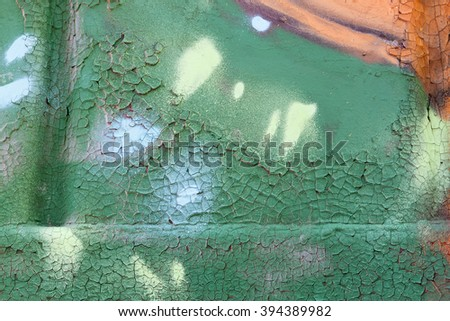 Scratched colored metal plate as a texture - stock photo