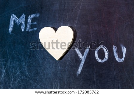 """scratched school board with """"me"""" and """"you"""" text, with wooden heart - stock photo"""
