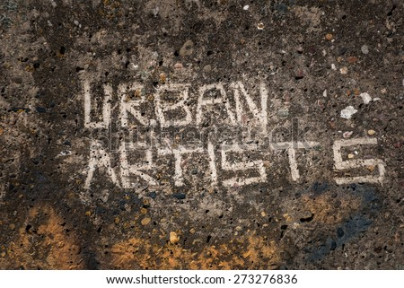 "Scratched ""urban artists"" graffiti on a concrete wall. - stock photo"