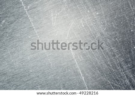 scratching an old metal background texture - stock photo