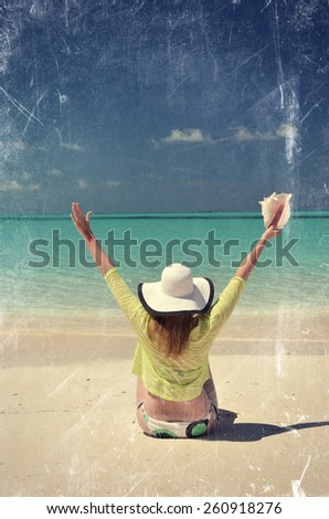 Scrated film effects. Girl at the ocean. Great Exuma, Bahamas. - stock photo