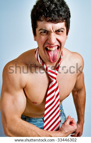 Scream of powerful funny guy with tongue out - stock photo