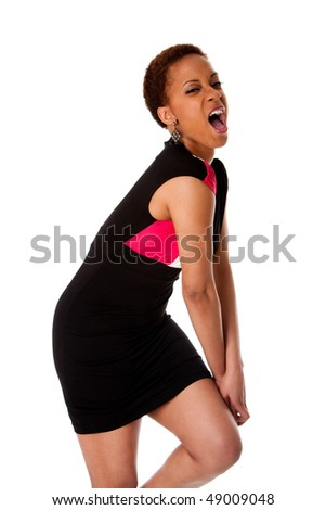 Screaming African American business woman wearing black dress expressing aggressively, isolated. - stock photo