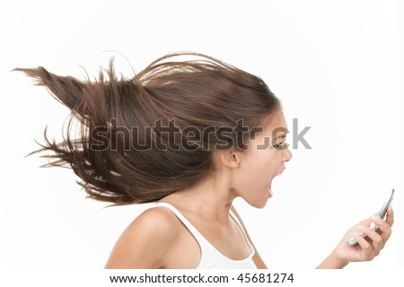 Screaming angry woman on the mobile phone. Dynamic and energetic image of young mixed race chinese / caucasian woman isolated on seamless white background. - stock photo