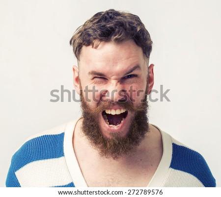 Screaming beard man portrait - stock photo
