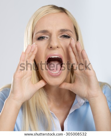Screaming blonde woman on white background - stock photo