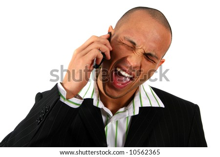 Screaming Business-Man Stylish young man in suit screaming into his cell phone. Isolated over white. - stock photo