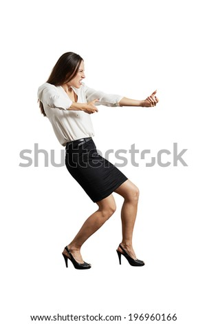 screaming businesswoman pulling invisible rope. isolated on white background - stock photo