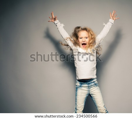 Screaming girl. Crazy child. Naughty, disobedient kid - stock photo