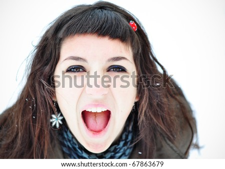 Screaming girl outside in winter time - stock photo