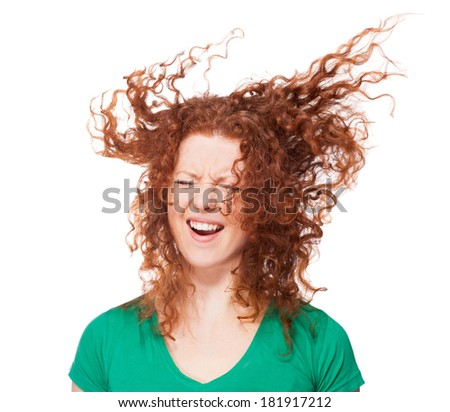 Screaming girl with flying hair - stock photo