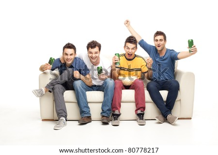 screaming group of young men watching television with beer and popcorn - stock photo