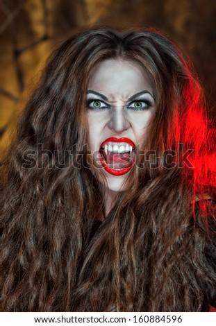 Screaming halloween beautiful vampire  - stock photo