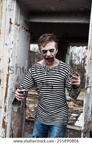 Screaming insane zombie in abandoned empty house - stock photo