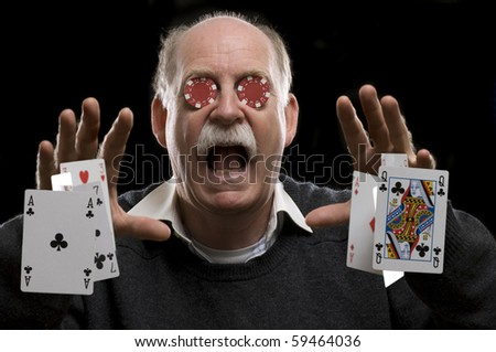 Screaming man Throwing cards with chips in his eyes - stock photo