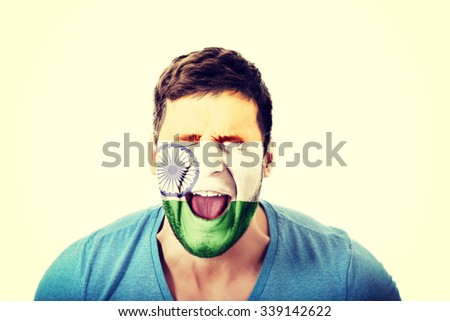 Screaming man with India flag painted on face. - stock photo