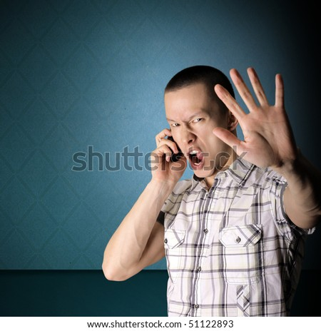 screaming man with open hand and mobile phone